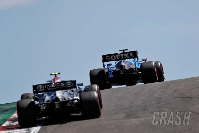 George Russell (GBR) Williams Racing FW43B leads Valtteri Bottas (FIN) Mercedes AMG F1 W12.