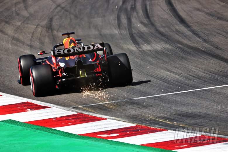 Max Verstappen (NLD) Red Bull Racing RB16B sends sparks flying.