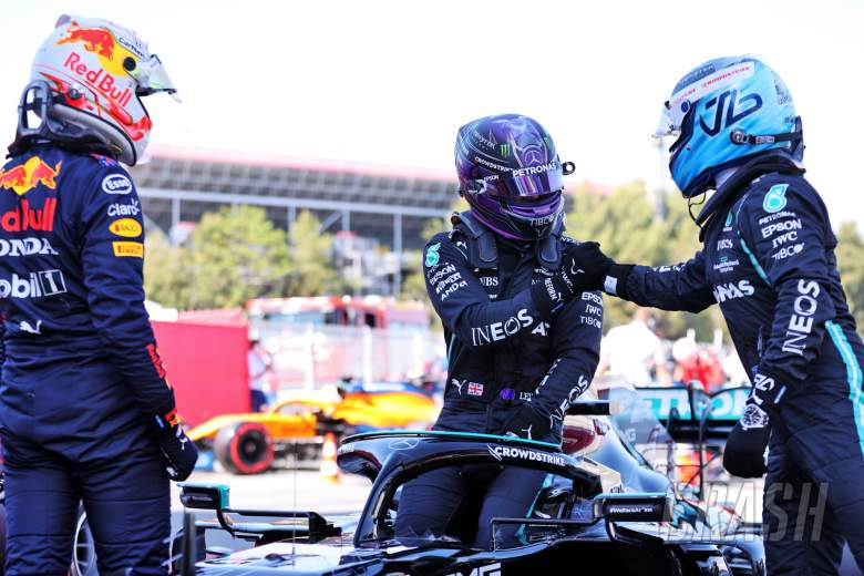 Lewis Hamilton (GBR) Mercedes AMG F1 W12 (Centre) celebrates his 100th pole position in qualifying parc ferme with team mate Valtteri Bottas (FIN) Mercedes AMG F1 (Right) and Max Verstappen (NLD) Red Bull Racing (Left).