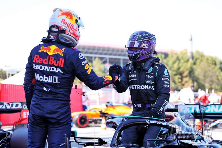 Lewis Hamilton (GBR) Mercedes AMG F1 W12 celebrates his 100th pole position in qualifying parc ferme with second placed Max Verstappen (NLD) Red Bull Racing.