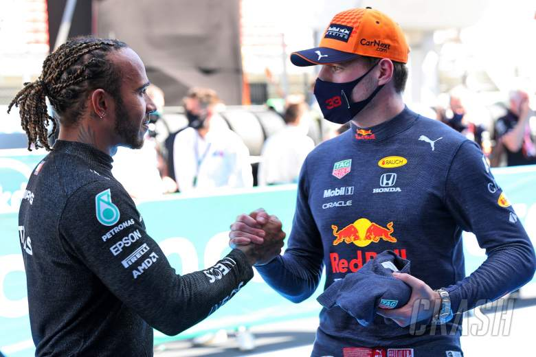 (L to R): Lewis Hamilton (GBR) Mercedes AMG F1 celebrates his 100th pole position in qualifying parc ferme with second placed Max Verstappen (NLD) Red Bull Racing.