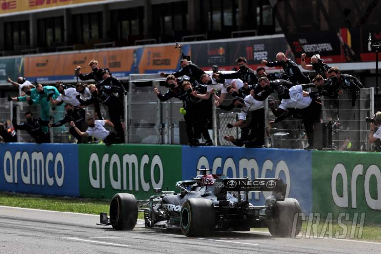 Race winner Lewis Hamilton (GBR) Mercedes AMG F1 W12 passes his celebrating team at the end of the race.