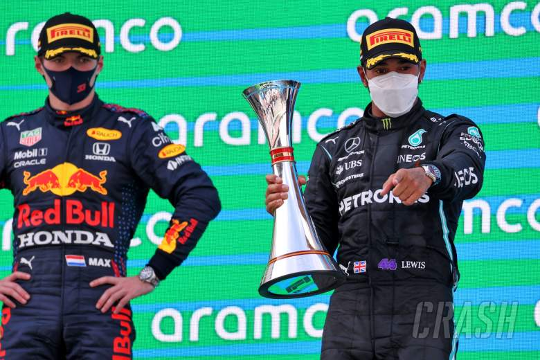 Race winner Lewis Hamilton (GBR) Mercedes AMG F1 celebrates on the podium with Max Verstappen (NLD) Red Bull Racing (Left).