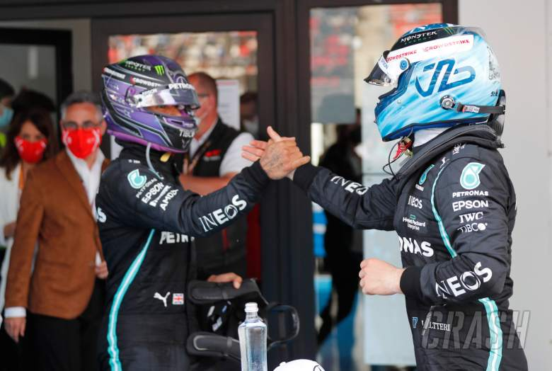 (L to R): Race winner Lewis Hamilton (GBR) Mercedes AMG F1 in parc ferme with third placed team mate Valtteri Bottas (FIN) Mercedes AMG F1.