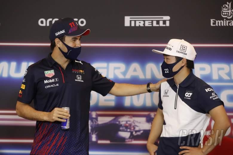 (L to R): Sergio Perez (MEX) Red Bull Racing and Yuki Tsunoda (JPN) AlphaTauri in the FIA Press Conference.