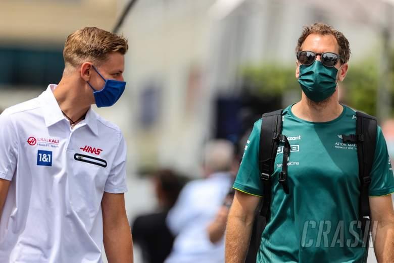(L to R): Mick Schumacher (GER) Haas F1 Team with Sebastian Vettel (GER) Aston Martin F1 Team.
