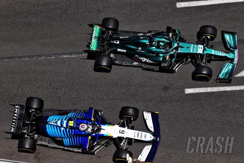 Lance Stroll (CDN) Aston Martin F1 Team AMR21 and Nicholas Latifi (CDN) Williams Racing FW43B.