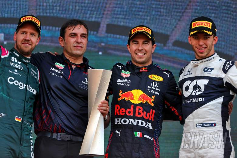 The podium (L to R): Sebastian Vettel (GER) Aston Martin F1 Team; second; Pierre Wache (FRA) Red Bull Racing Technical Director; Sergio Perez (MEX) Red Bull Racing, race winner; Pierre Gasly (FRA) AlphaTauri, third.