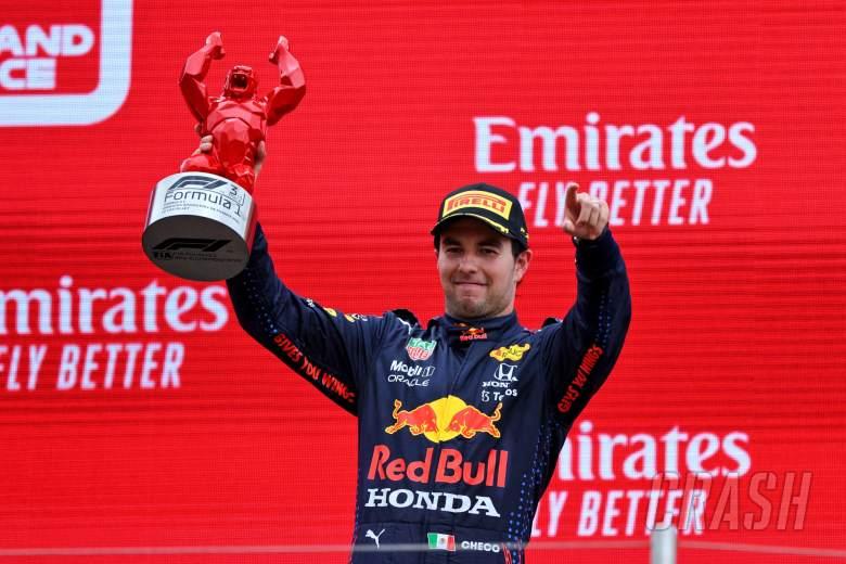 Sergio Perez (MEX) Red Bull Racing celebrates his third position on the podium.