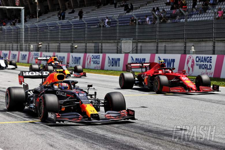 Sergio Perez (MEX) Red Bull Racing RB16B and Carlos Sainz Jr (ESP) Ferrari SF-21 - practice starts.