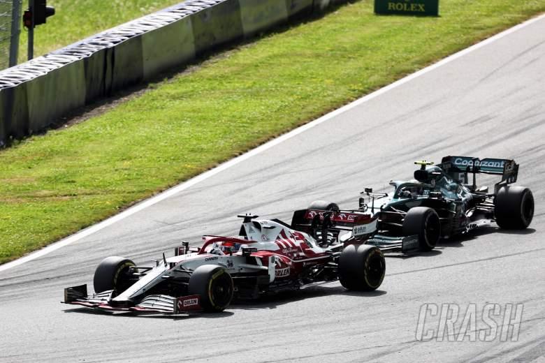 Kimi Raikkonen (FIN) Alfa Romeo Racing C41 and Sebastian Vettel (GER) Aston Martin F1 Team AMR21 battle for position.