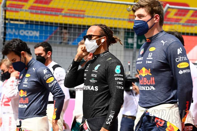 Lewis Hamilton (GBR) Mercedes AMG F1 and Max Verstappen (NLD) Red Bull Racing on the grid.