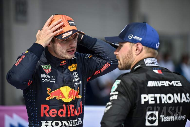 (L to R): Race winner Max Verstappen (NLD) Red Bull Racing with second placed Valtteri Bottas (FIN) Mercedes AMG F1 in parc ferme.