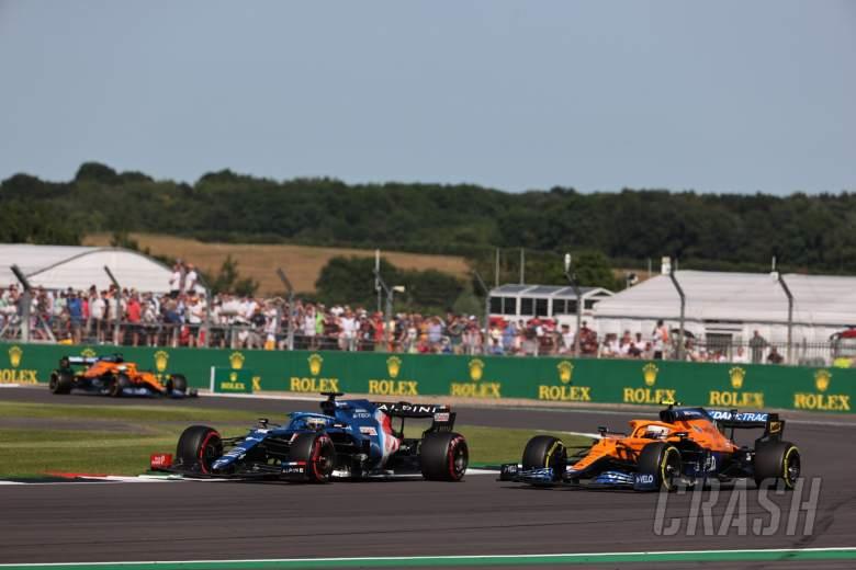Fernando Alonso (ESP) Alpine F1 Team A521 and Daniel Ricciardo (AUS) McLaren MCL35M.
