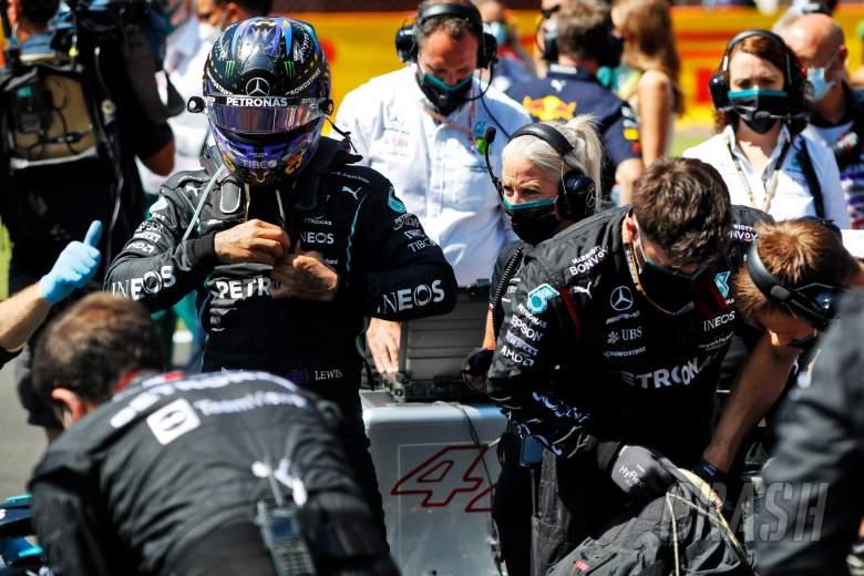 Lewis Hamilton (GBR) Mercedes AMG F1 on the grid.