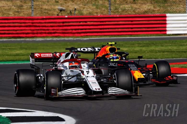 Kimi Raikkonen (FIN) Alfa Romeo Racing C41 and Sergio Perez (MEX) Red Bull Racing RB16B battle for position.