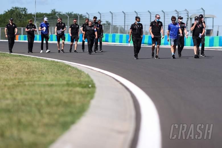 Fernando Alonso (ESP) Alpine F1 Team and Esteban Ocon (FRA) Alpine F1 Team walk the circuit with the team.