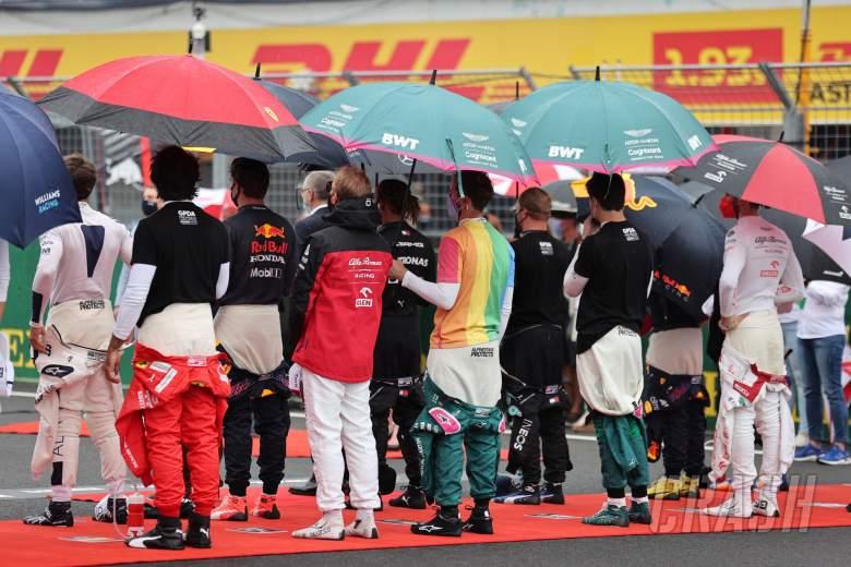 Sebastian Vettel (GER) Aston Martin F1 Team wearing a rainbow t-shirt as the grid observes the national anthem.
