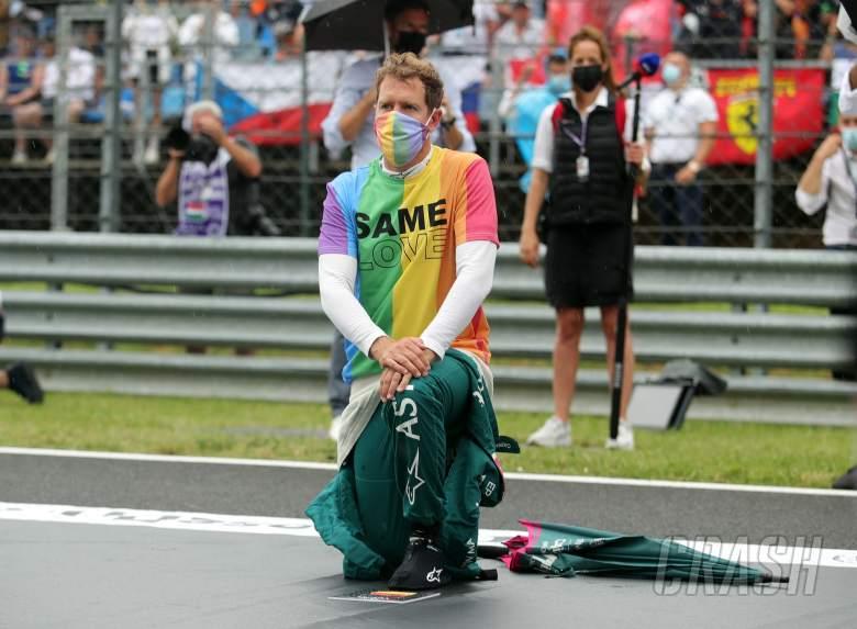 Sebastian Vettel (GER) Aston Martin F1 Team on the grid.