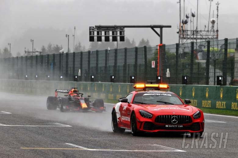Max Verstappen (NLD) Red Bull Racing RB16B leads behind the Mercedes FIA Safety Car.