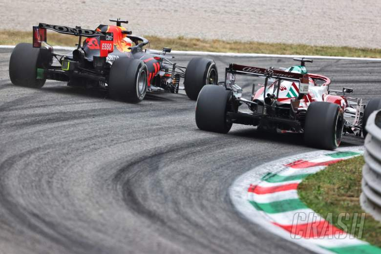 Max Verstappen (NLD) Red Bull Racing RB16B and Robert Kubica (POL) Alfa Romeo Racing C39 Reserve Driver.