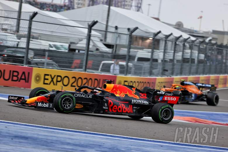 Lando Norris (GBR) McLaren MCL35M heads into the pits as Max Verstappen (NLD) Red Bull Racing RB16B passes him.
