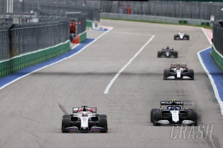 Nikita Mazepin (RUS) Haas F1 Team VF-21 and Nicholas Latifi (CDN) Williams Racing FW43B battle for position.