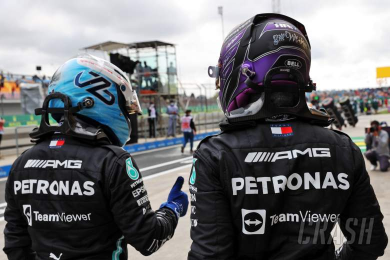 (L to R): Pole sitter Valtteri Bottas (FIN) Mercedes AMG F1 with team mate and fastest in qualifying Lewis Hamilton (GBR) Mercedes AMG F1 in parc ferme.