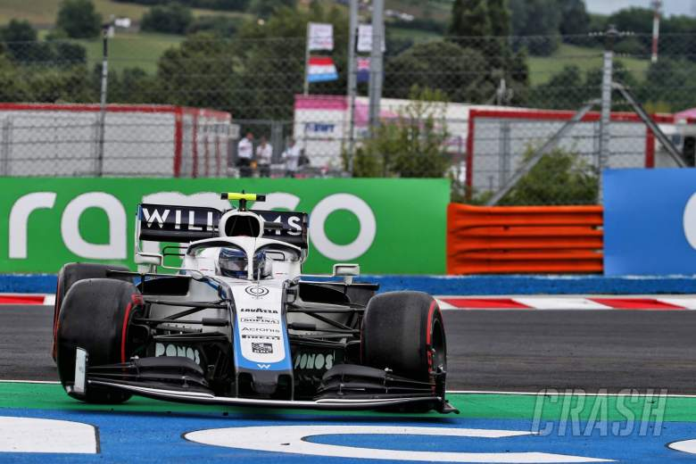 Nicholas Latifi (CDN) Williams Racing FW43 spins with a puncture.