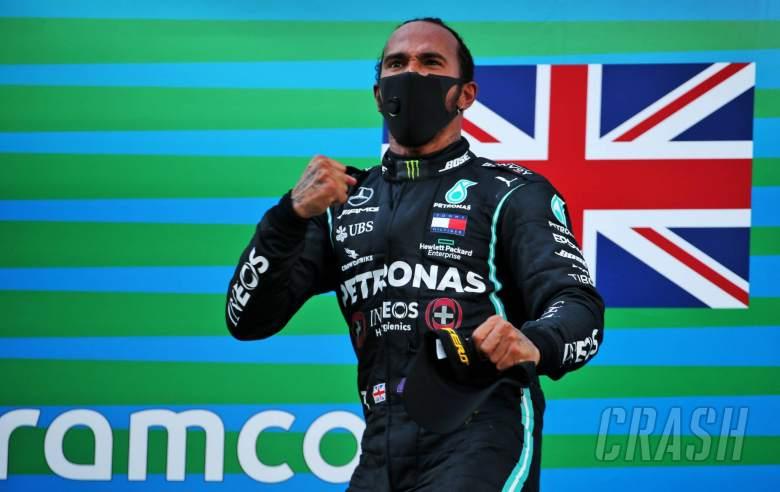 Race winner Lewis Hamilton (GBR) Mercedes AMG F1 celebrates on the podium.