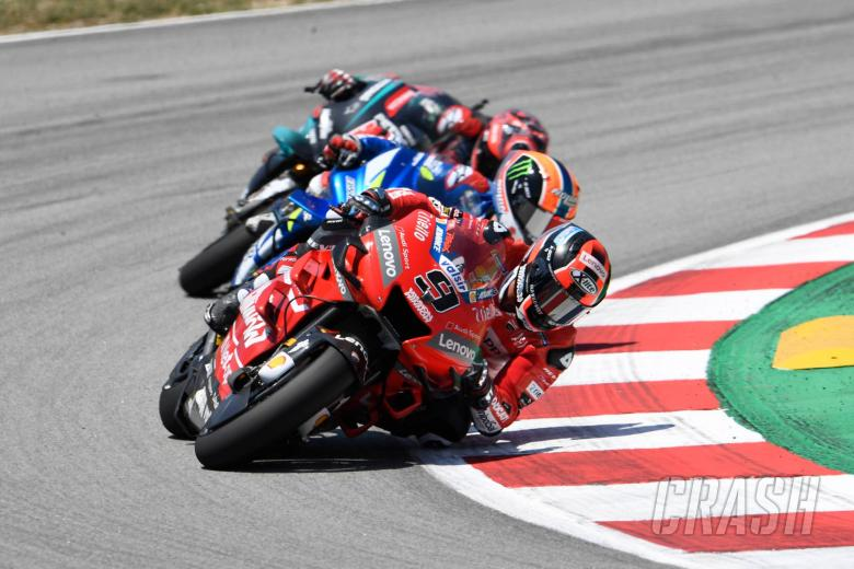 Petrucci survives rubbery brush with Rins for podium