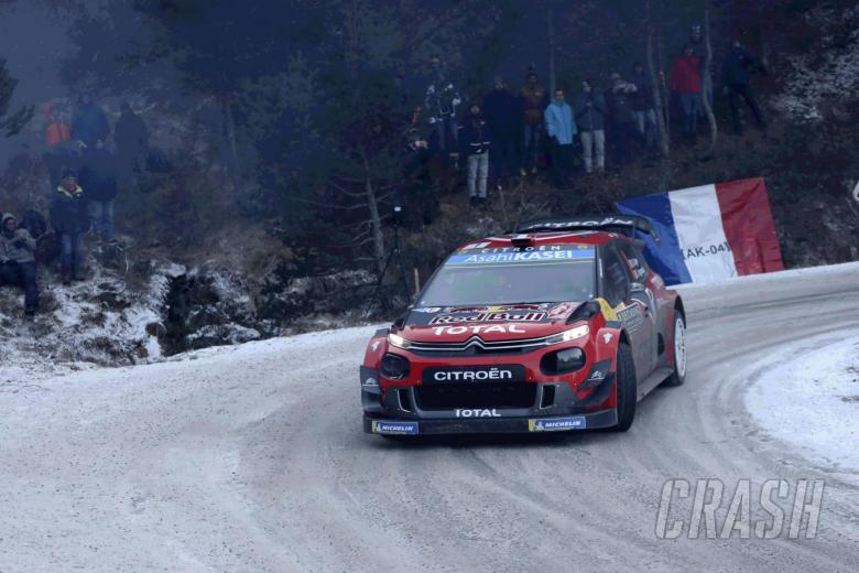 Ogier withstands Neuville pressure