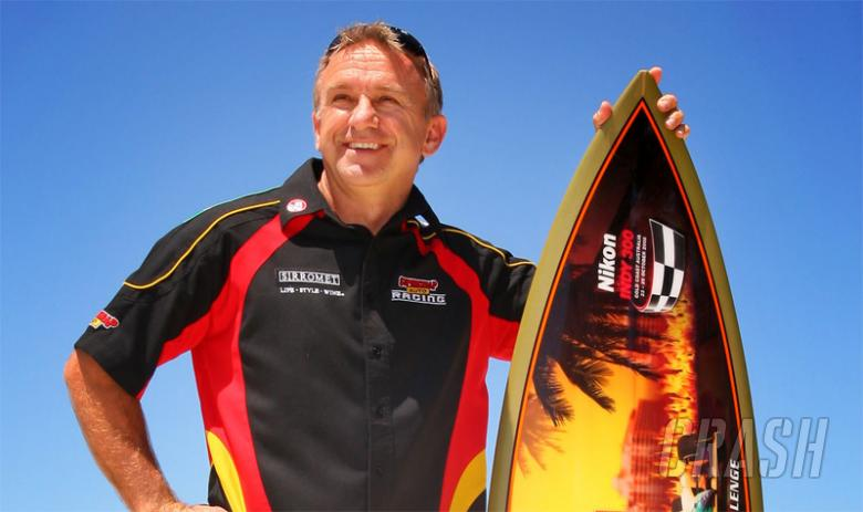 Ingall chasing Indy surfboard.