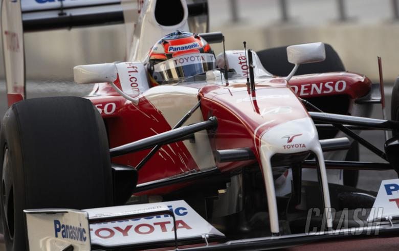 Timo Glock speeds through the spray at Jerez