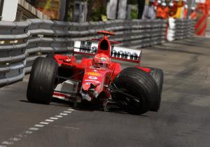 Michael Schumacher limps back to the pits in the damaged Ferrari F2004