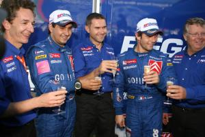 Sebastien Loeb and Daniel Elena celebrate their Cyprus win with Kronos boss, Marc van Dalen and co W