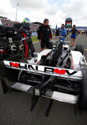 Zsolt Baumgartner`s unbranded Minardi F1 as a mark of respect for departed sporting director John Wa