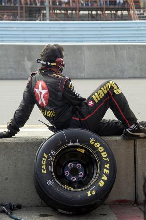 One of Jamie McMurray`s crew members waits on pit road at Watkins Glen.