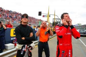 Rick Kelly (L) his dad and team owner (John Kelly (C) and Garth Tander (R) former team mate watch th