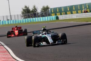 Bottas handed time penalty for Ricciardo collision