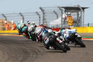 Jaume Masia leads pack, last corner, Moto3 race, Aragon MotoGP. 18 October 2020