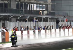Zarco, Rossi, Marquez back wet night race