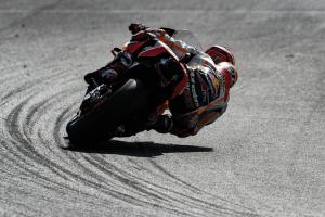 Marquez beats Lorenzo, Dovizioso to top spot