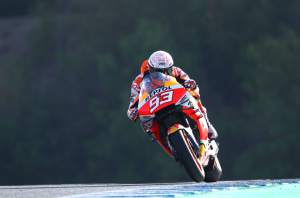 Marquez holds off Yamahas in warm-up, big fall for Crutchlow