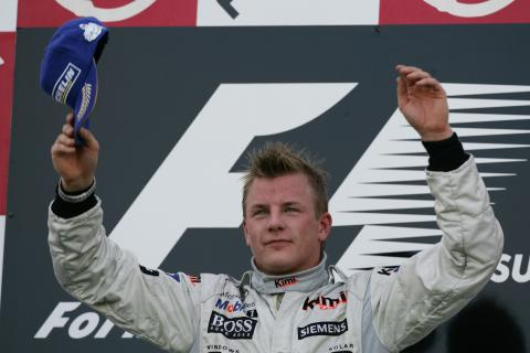 McLaren`s Kimi Raikkonen celebrates his win at Suzuka
