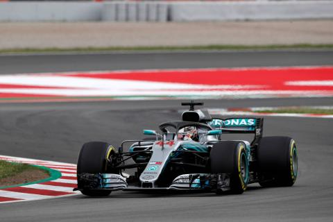 Hamilton charges to Spanish GP pole for Mercedes