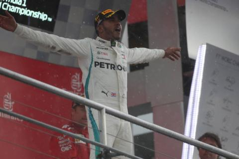 Hamilton charges from 14th to German GP win, Vettel crashes out