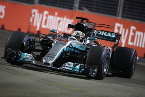 Hamilton takes crucial Singapore win as Vettel crashes out