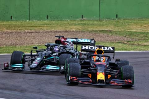 Max Verstappen (NLD) Red Bull Racing RB16B leads Lewis Hamilton (GBR) Mercedes AMG F1 W12.