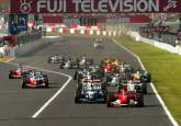 Michael Schumacher leads the field away at the start of the Japanese Grand Prix at Suzuka